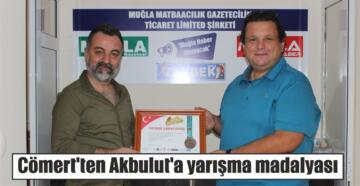Cömert'ten Akbulut'a yarışma madalyası